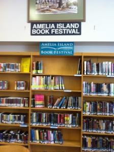 Amela Island Book Festival shelf at the Fernandina Beach library